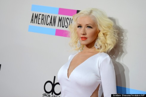Christina Aguilera arrives at the American Music Awards at the Nokia Theatre L.A. Live on Sunday, Nov. 24, 2013, in Los Angeles. (Photo by Jordan Strauss/Invision/AP)