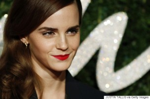 English actress Emma Watson poses for pictures on the red carpet upon arrival to attend the British Fashion Awards 2014 in London on December 1, 2014. AFP PHOTO/JUSTIN TALLIS (Photo credit should read JUSTIN TALLIS/AFP/Getty Images)