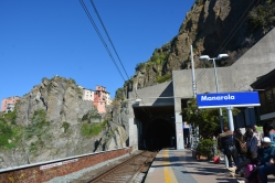 The station- sea on one side, mountain on the other