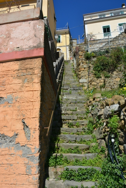 steps cut into the mountain to make your way around the village