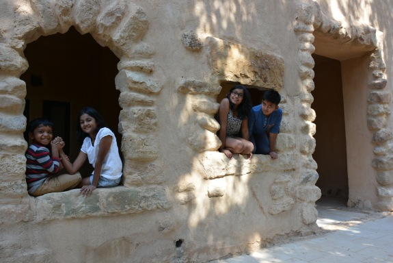 The kids loving the windows in the stone walls of the rooms