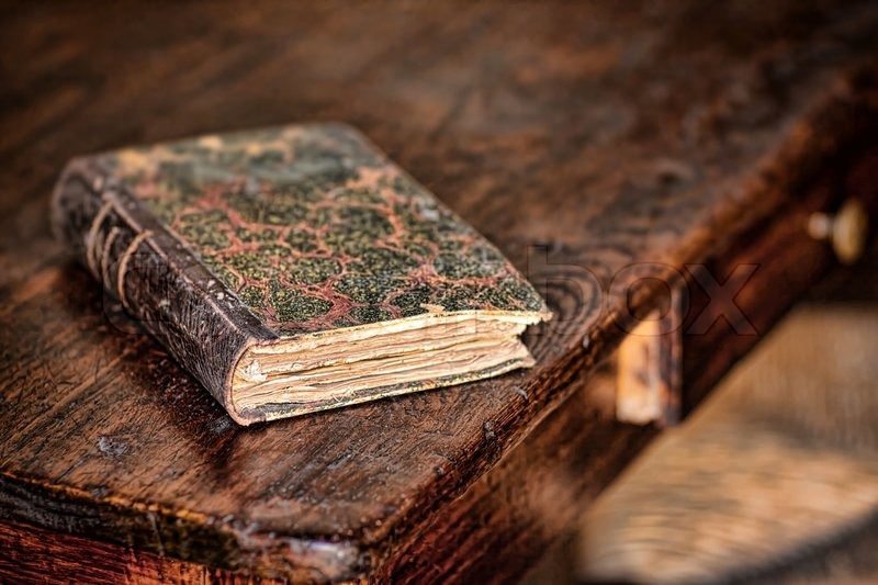 old-book-on-the-wooden-table