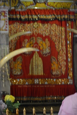 The Tooth is kept behind these curtains on a lotus flower made of gold