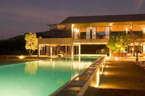 A view of the pool with the breakfast hall in the background