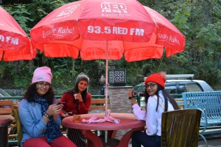 Enjoying hot tea at the restaurant opposite the falls